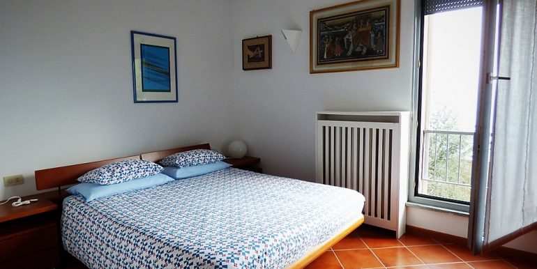 Bedroom with large window in San Siro