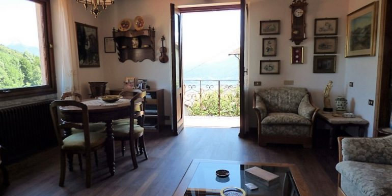 Living room and views from villa with lake view and garden